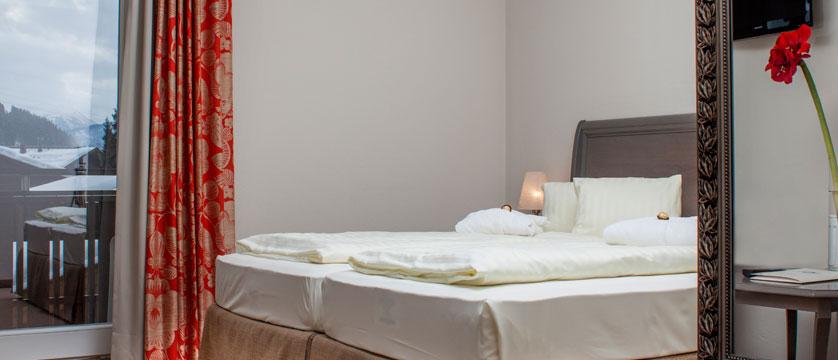 austria_st-johann_sporthotel-austria_bedroom2.jpg